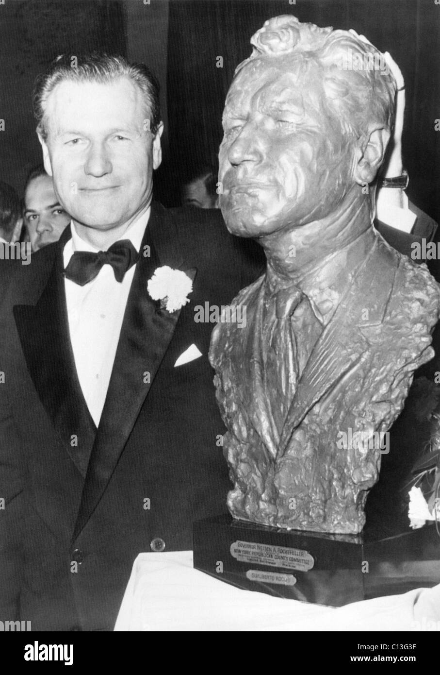 Rockefeller Family. New York Governor Nelson Rockefeller with a bust of himself by Italian sculptor Gualberto Rocchi. - Stock Image