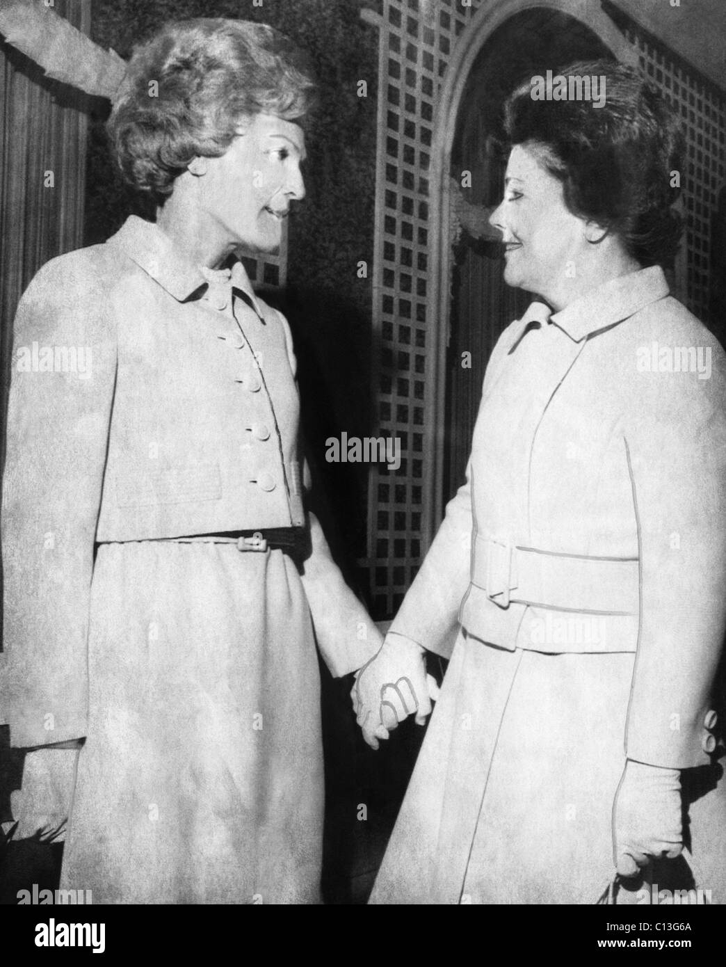 First Lady Patricia Nixon hold hands with Second Lady Judy Agnew (wife of Vice President Spiro Agnew). - Stock Image