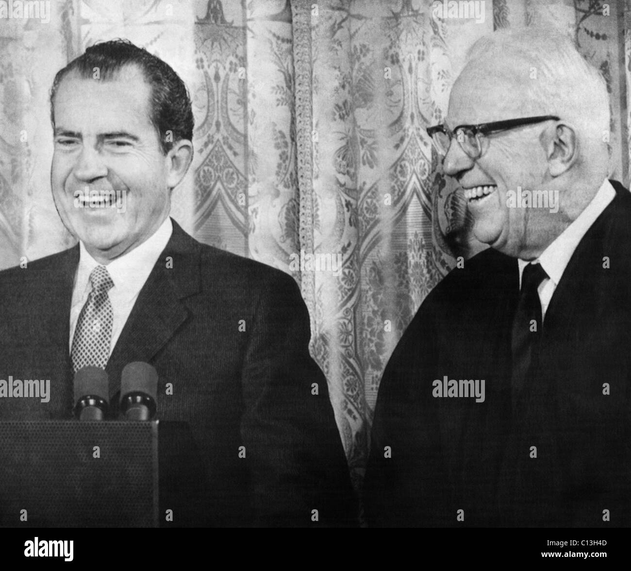 Nixon Presidency. US President Richard Nixon with Chief Justice of the Supreme Court Earl Warren, who was invited - Stock Image
