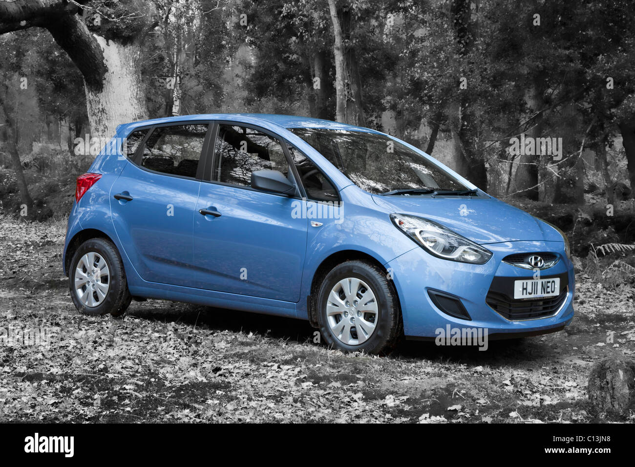 New Hyundai iX20 11 reg blue hatchback estate compact MPV car on b/w background - Stock Image