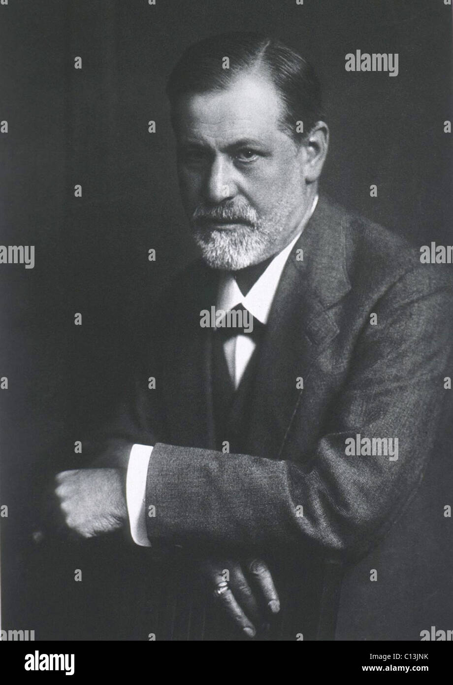 Sigmund Freud (1856-1939), with arms resting on back of chair. Photogravure by Max Halberstadt, who was also the Stock Photo