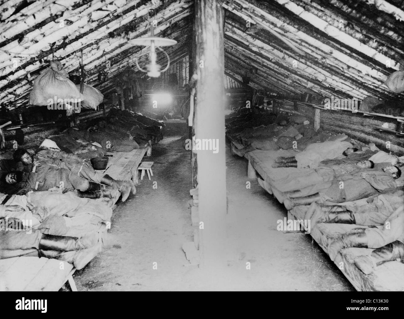 Russian convicts' sleeping quarters in a primitive Siberian prison camp barracks. Khabarovsk area in far eastern - Stock Image