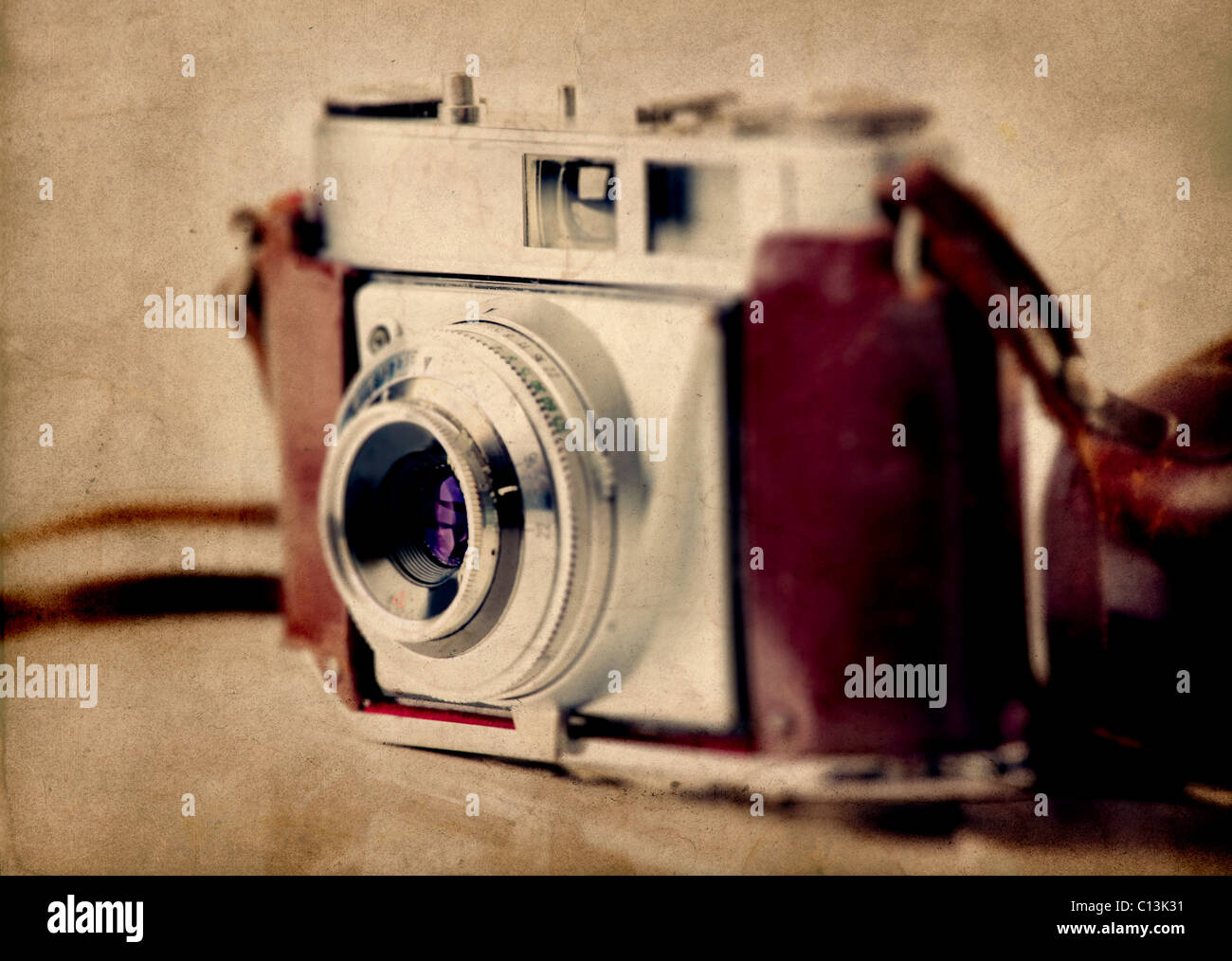 Old fashioned photography camera isolated over a white background - Stock Image