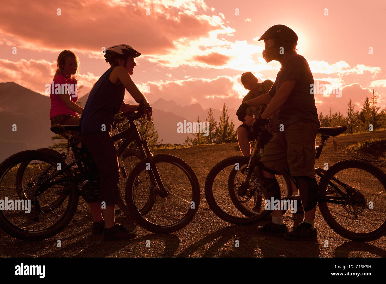 Canada, British Columbia, Fernie, Four people on bike trip - Stock Image