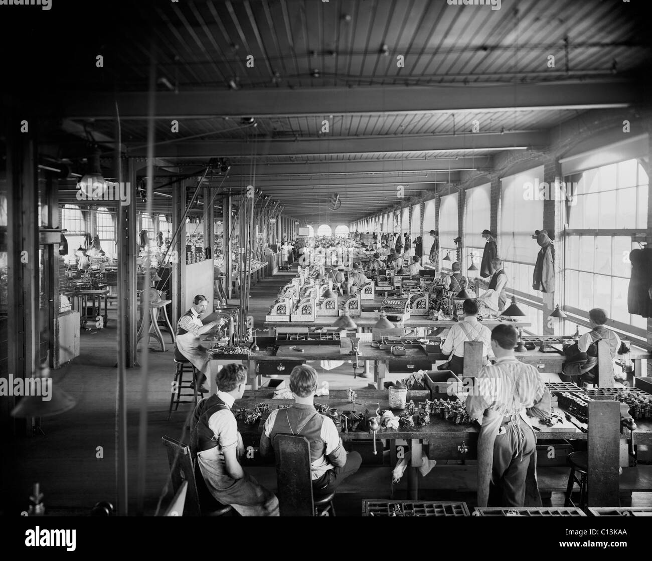 Assembling department, National Cash Register, Dayton, Ohio demonstrates mass production of precisely made complex - Stock Image