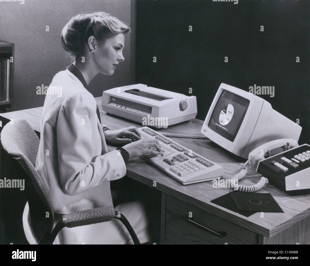 Women using and early personal computer made by the Digital