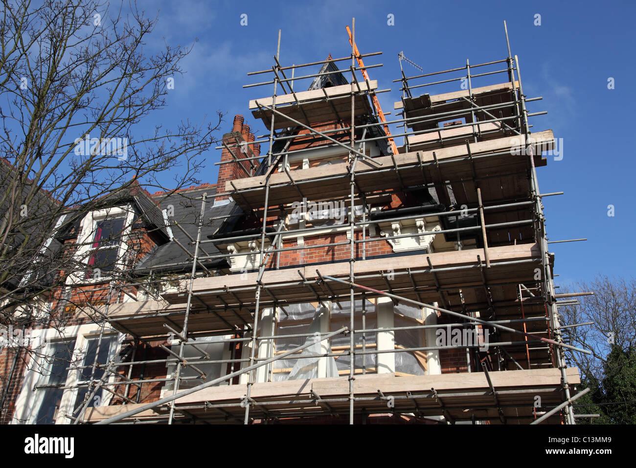 Scaffolding on a renovation in a U.K. city. - Stock Image