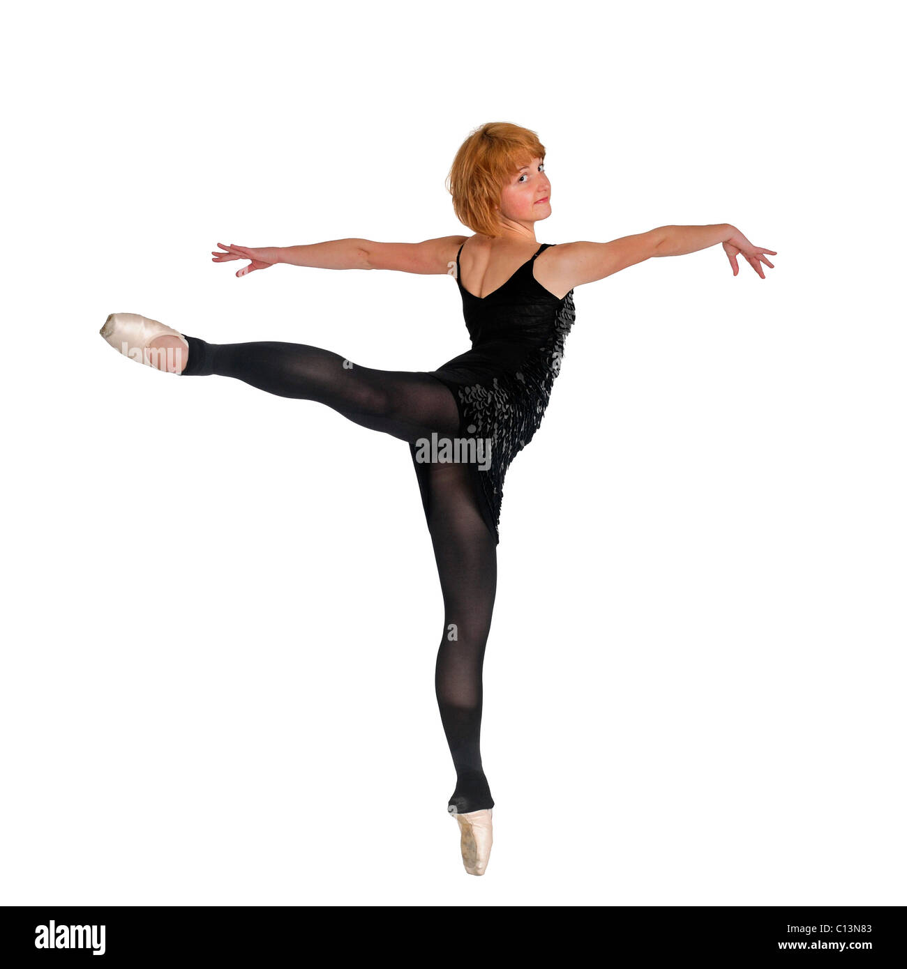 Female Ballet Dancer balances on her tows On white Background - Stock Image