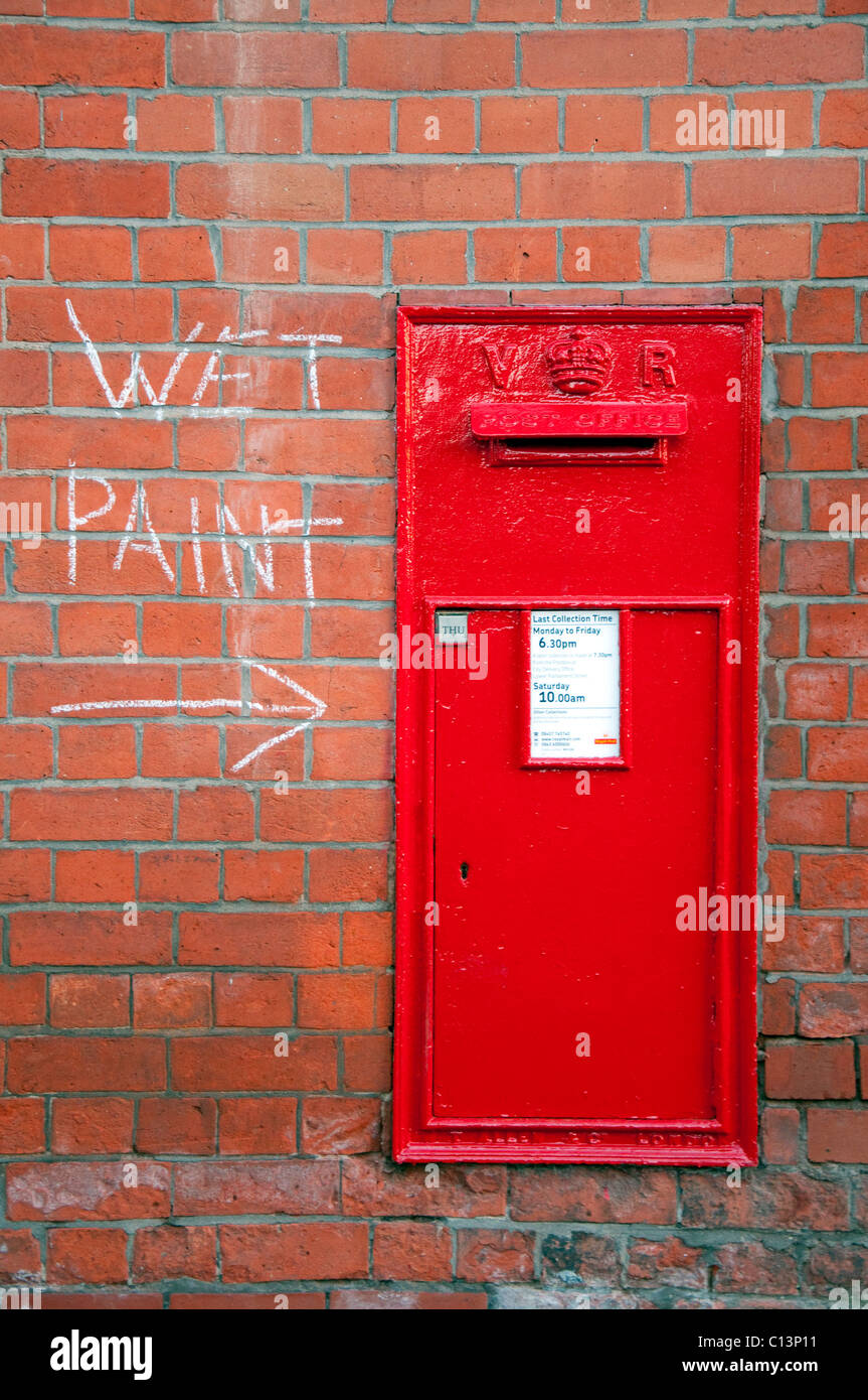A traditional red post box. - Stock Image