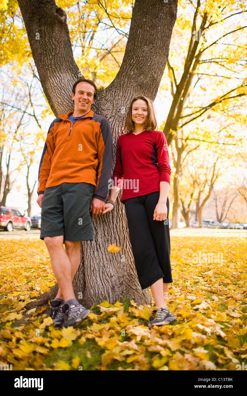 USA, Montana, Kalispell, Happy couple standing and holding hands in autumn - Stock Image