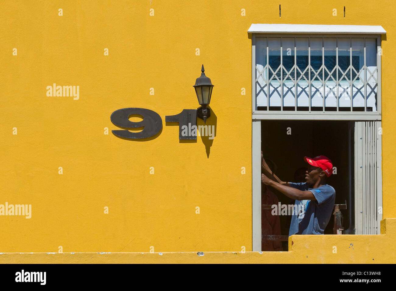 House painter at work, Bo Kaap, Cape Town, South Africa - Stock Image