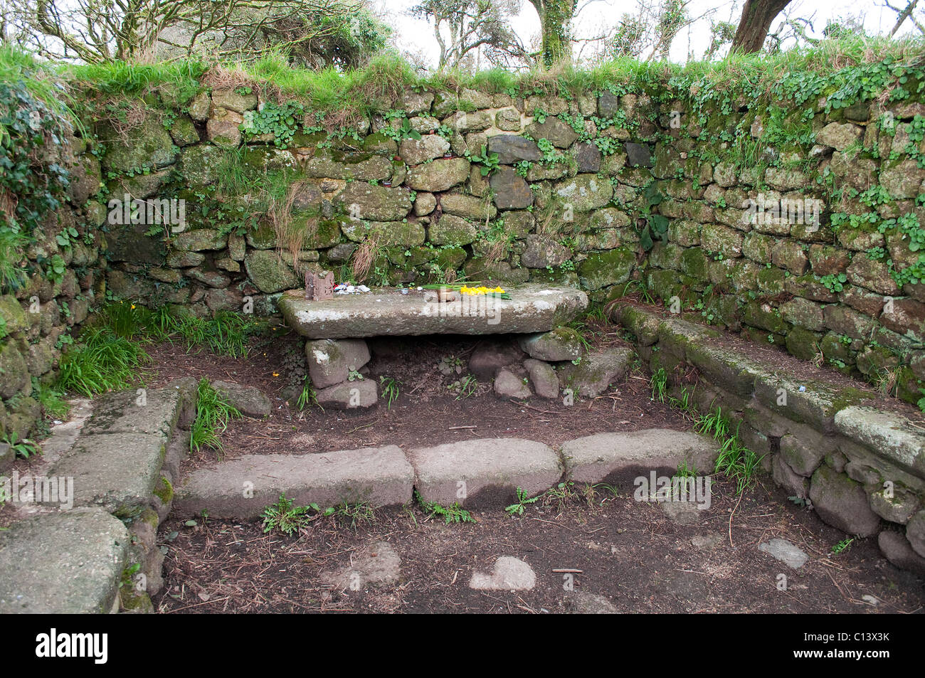 The alter in the ancient baptistry of boswarthen chapel near madron in cornwall, uk - Stock Image