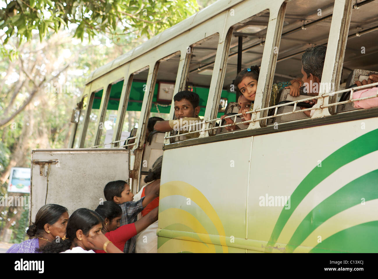 A child peeps out of a bus window, Kerala, india - Stock Image