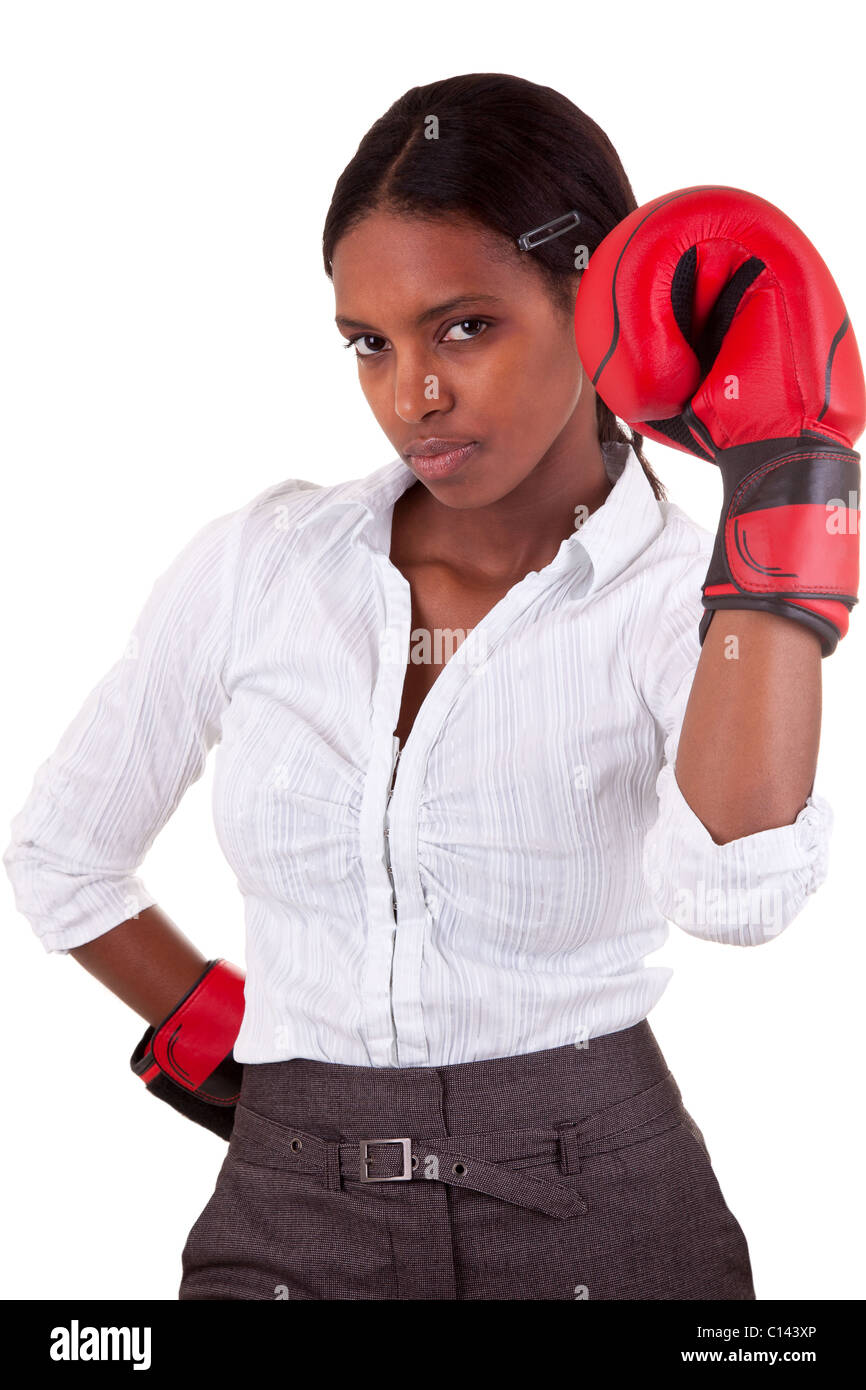young African American woman wearing boxing gloves Stock Photo