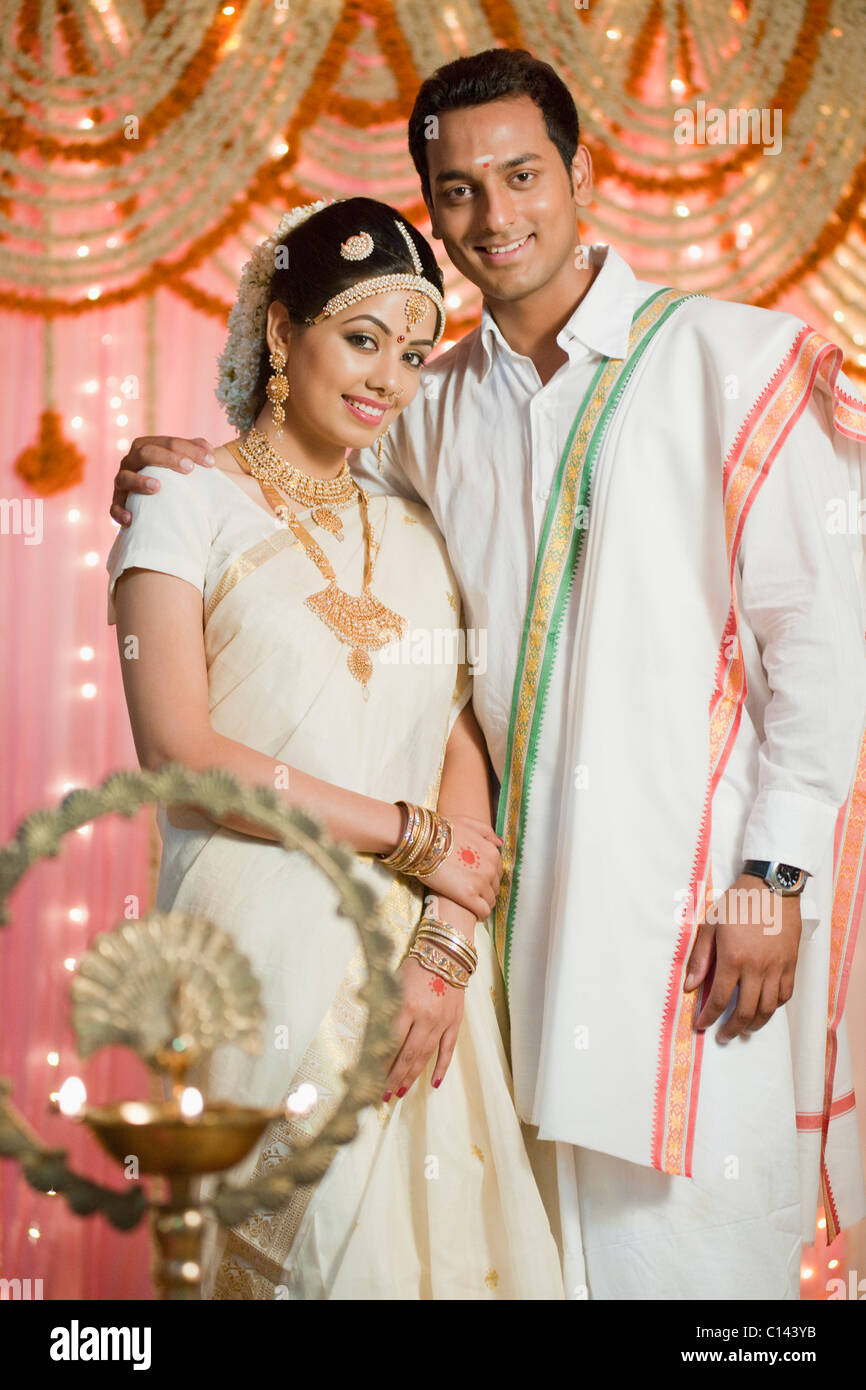 725c7f8749 Portrait of a newlywed couple in traditional South Indian dress - Stock  Image