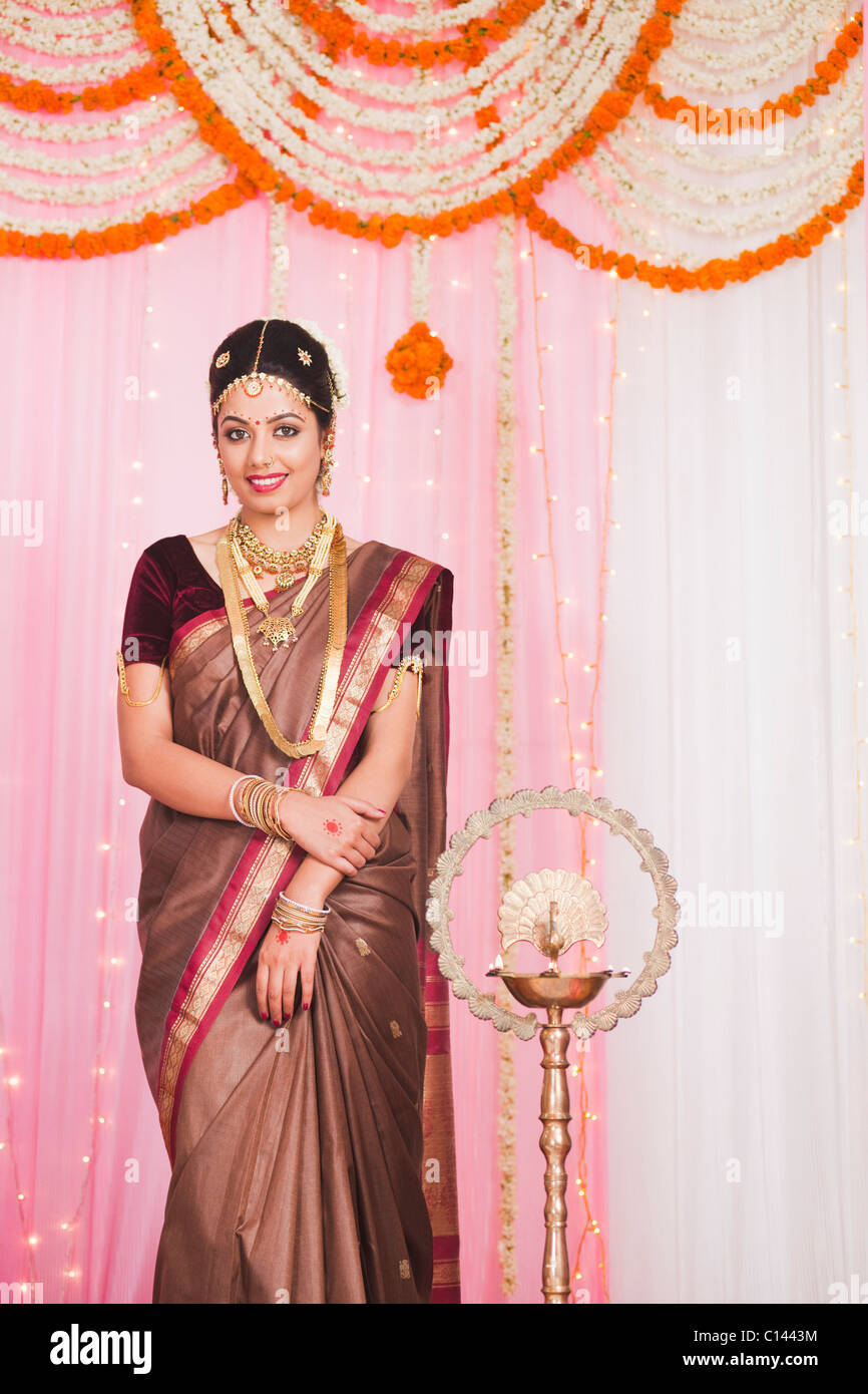 Bride In Traditional South Indian Dress Standing At Wedding
