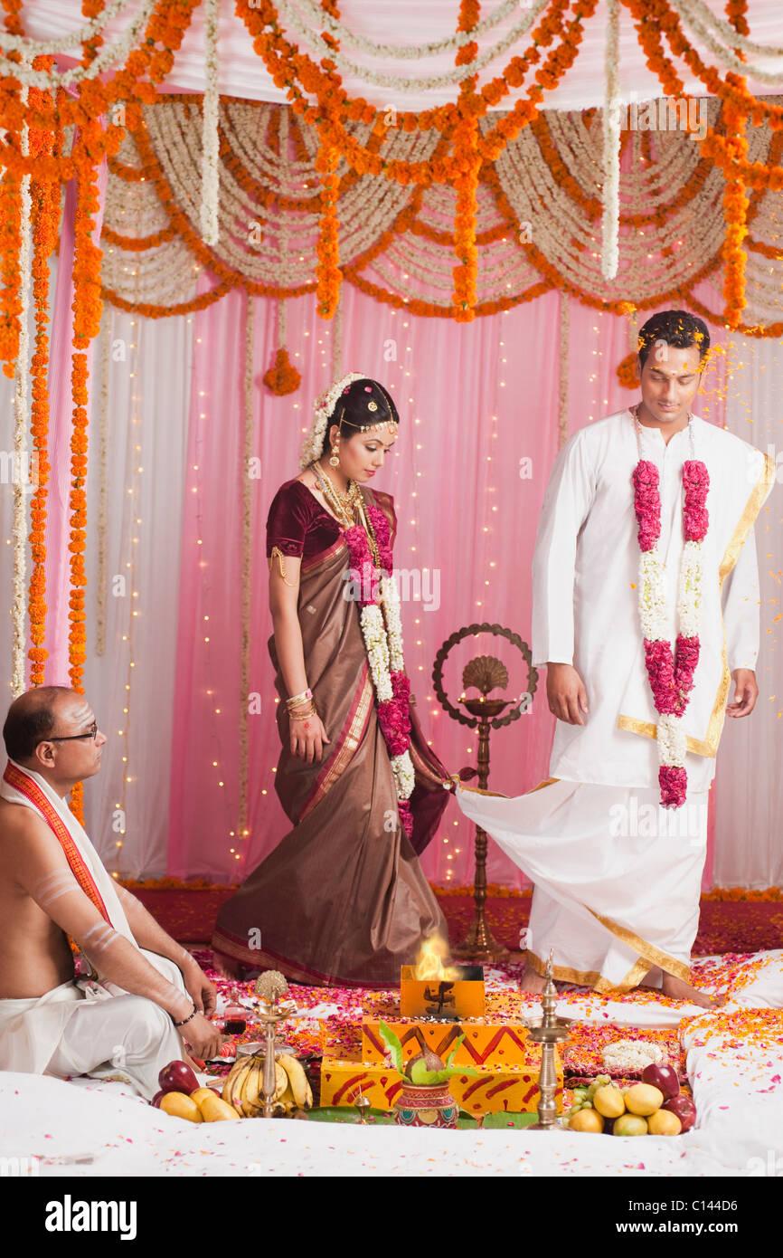 d503f649c460b Bride and bridegroom taking Saptha Padhi during South Indian wedding -  Stock Image