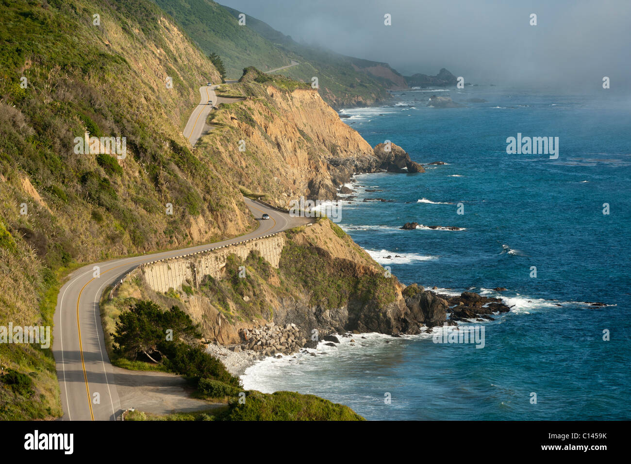 California Highway One winds along the Big Sur coastline. Near Monterey County mile marker 20.00.  Near Mill Creek - Stock Image