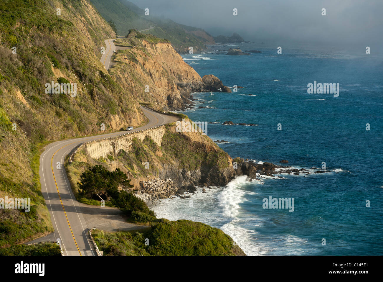 California Highway One winds along the Big Sur coastline. Near Monterey County mile marker 20.00 - Stock Image