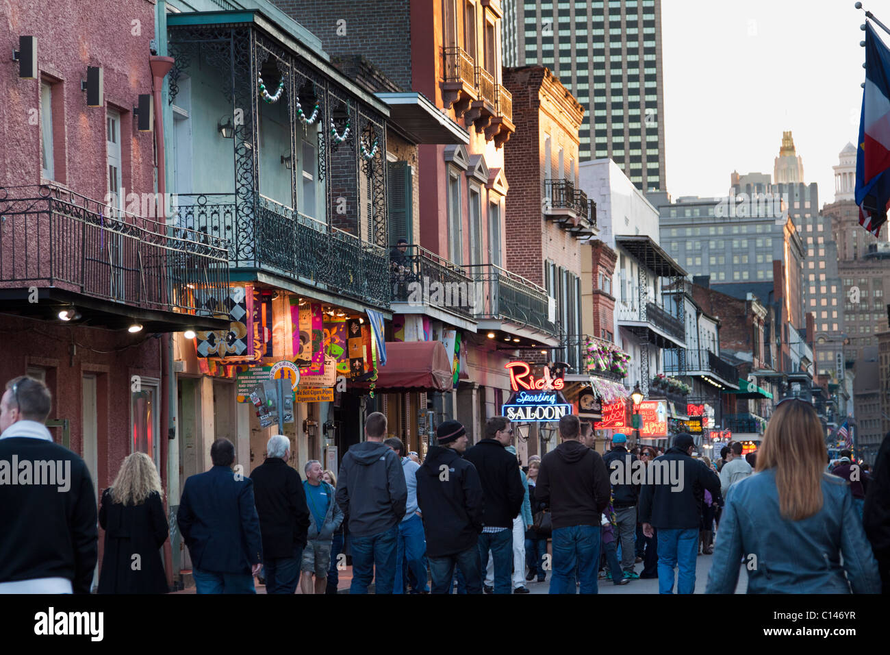 People cruising along bars and nightclubs on Bourbon Street at night in New Orleans - Stock Image