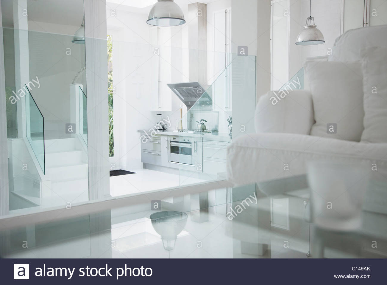 Elegant white living room and stainless steel kitchen - Stock Image