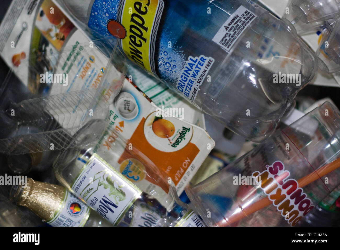 Close up of paper, plastic and glass recyclables - Stock Image