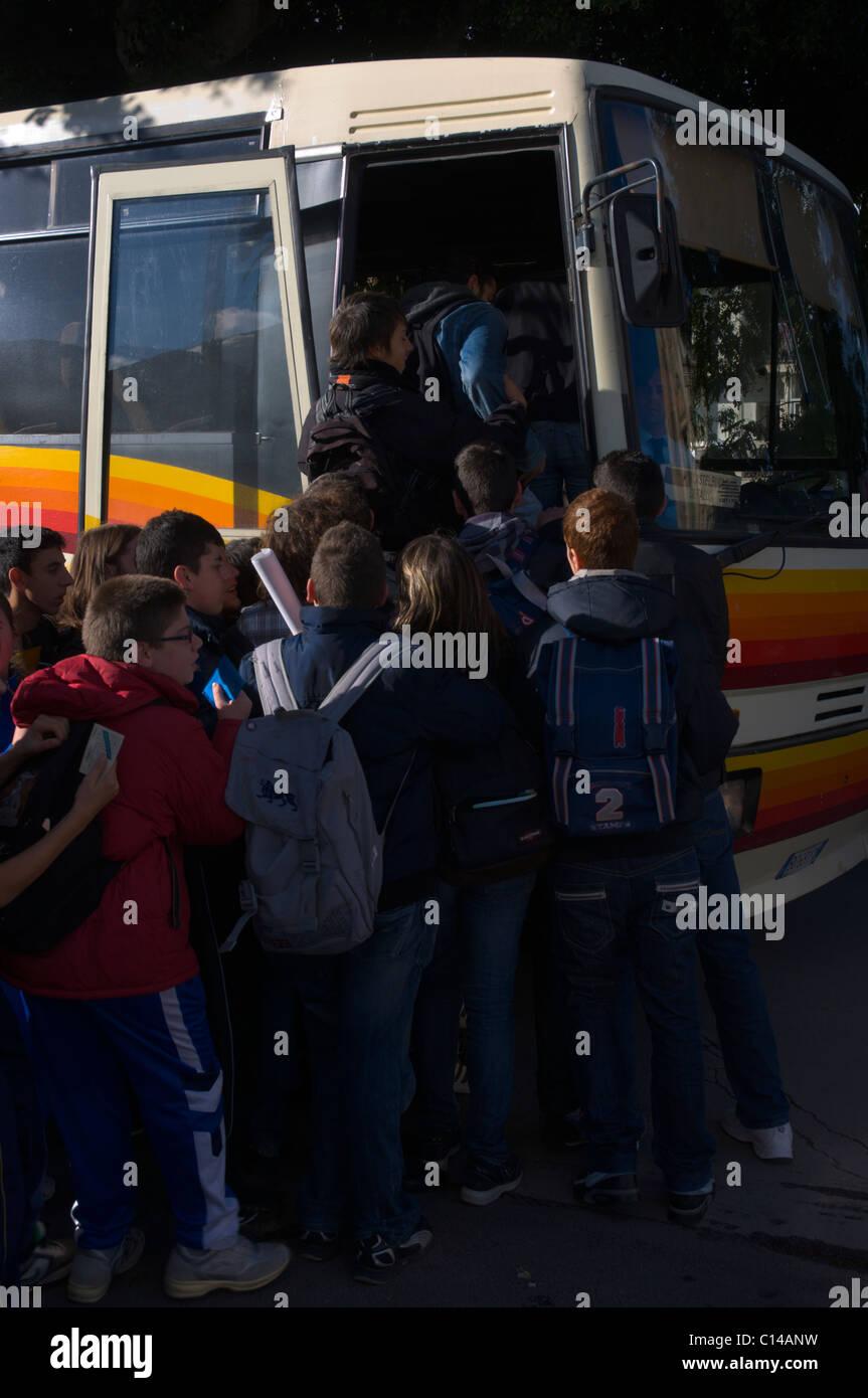 Students scramble onto a bus Cefalu town Sicilia Italy Europe - Stock Image
