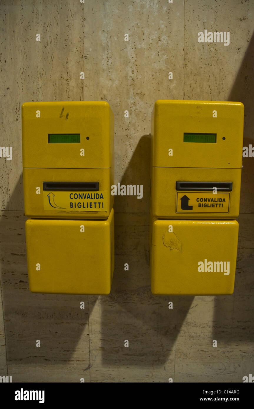 Ticket validating machines on platform Messina centrale railway station Messina city Sicily Italy Europe - Stock Image