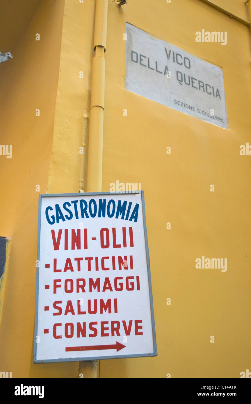 Sign of a delicacy shop selling olive oils wines cheese and other foods along centro storico the old town Naples - Stock Image
