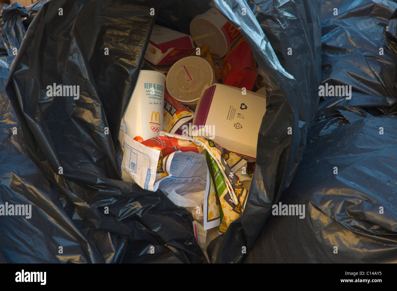 Rubbish bin full of wrappings and waste from fast food restaurants Naples Campania Italy Europe Stock Photo