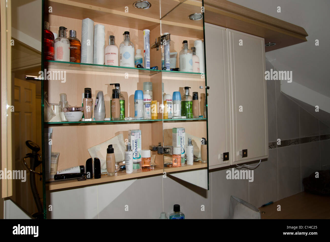 Toiletries and medicines in the Bathroom cabinet - Stock Image