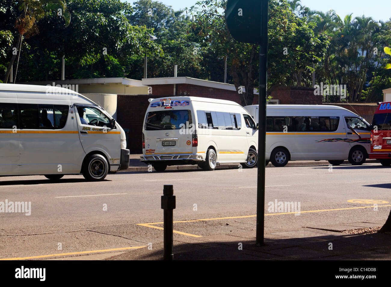 Minibus taxis offloading early morning commuters durban kwazulu natal south africa