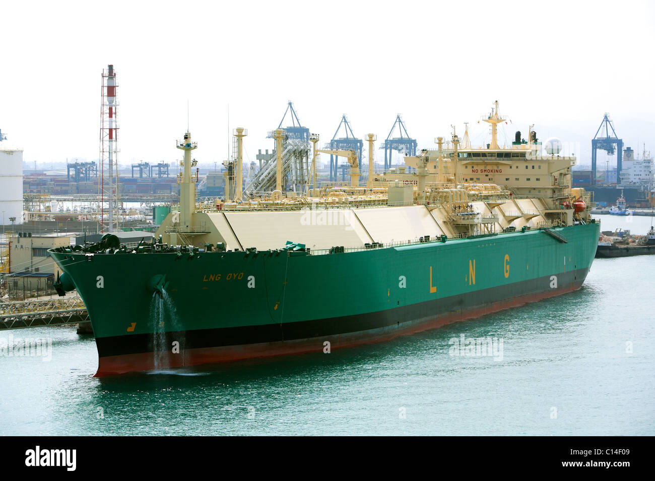 LNG tanker OYO alongside Barcelona Harbour dischaging cargo Stock Photo