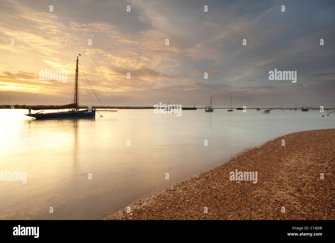 Boats captured at sunset on Mersea Island - Stock Image