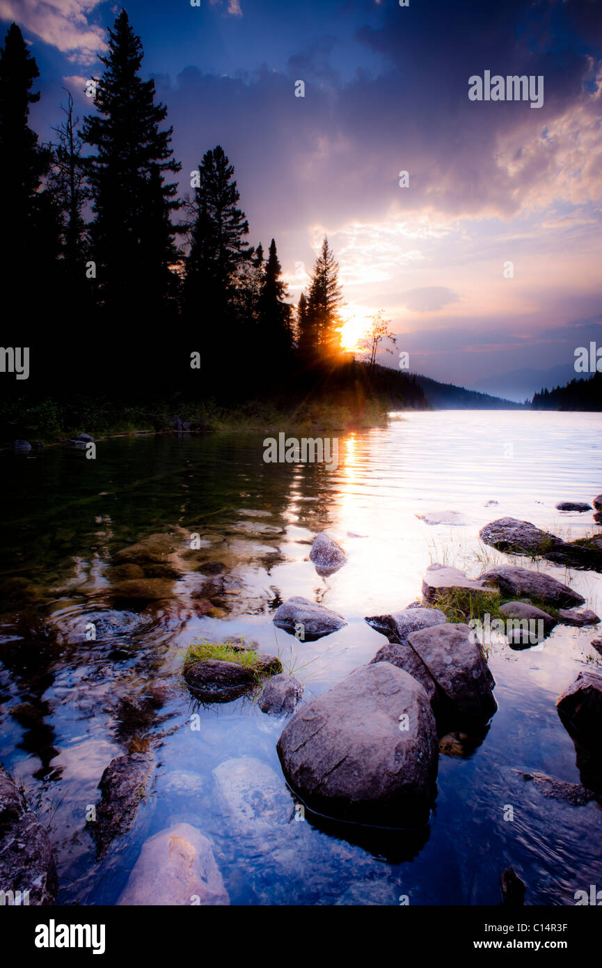 Lake with rocks  in the foreground.  Valley of the Five Lakes, Jasper National Park, Alberta, Canada. Stock Photo