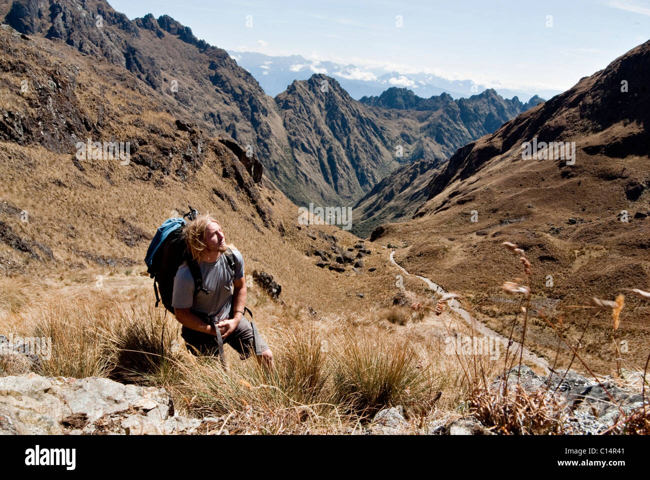 A young man reflects at the summit of Dead Woman's Pass on the Inca Trail. Stock Photo