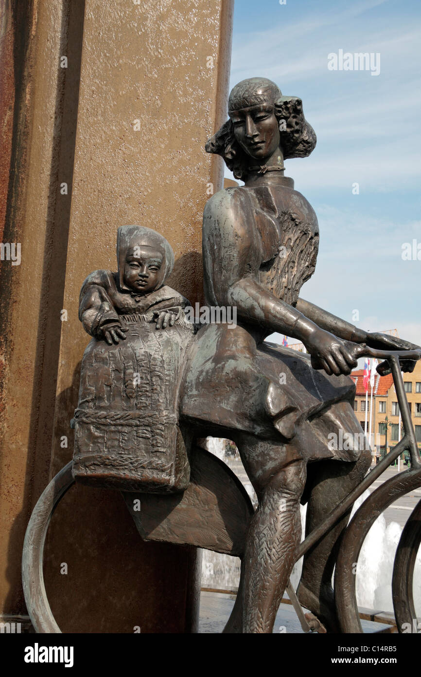 Close up of a woman and child on a bicycle, part of main fountain sculpture in the Zand Square, Bruges (Brugge), - Stock Image