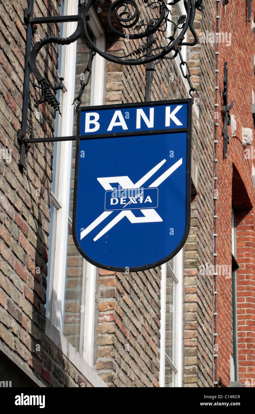 Logo sign above the Belgian-French Financial Institution Dexia branch in Bruges, Belgium. - Stock Image