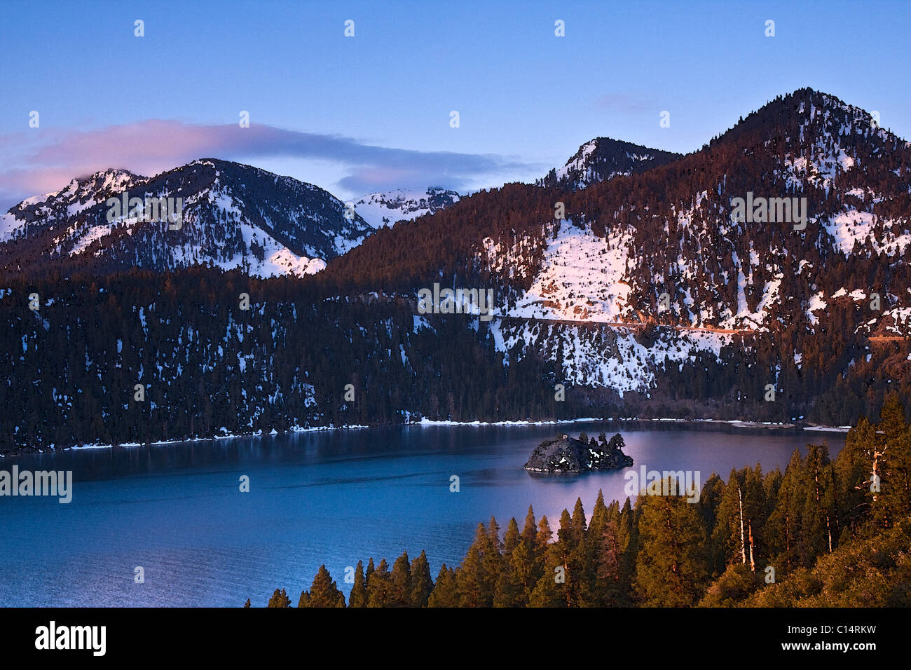 A watercolor of Emerald Bay, Wizard Island, and snow at Lake Tahoe in California - Stock Image
