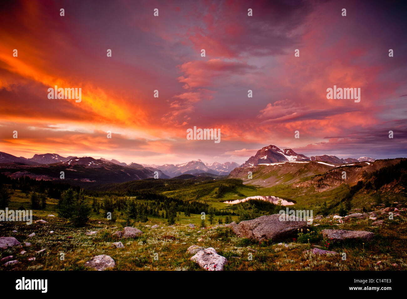 Sunrise from a ridge overlooking a mountain valley.  Banff National Park, Alberta, Canada. Stock Photo