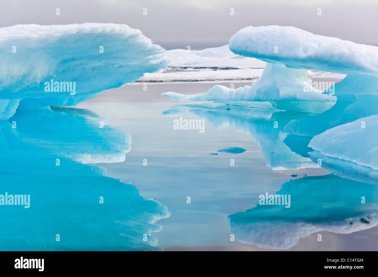 Mixed pack ice in Barrow Strait, Qikiqtaaluk Region, Nunavut, Canada. - Stock Image