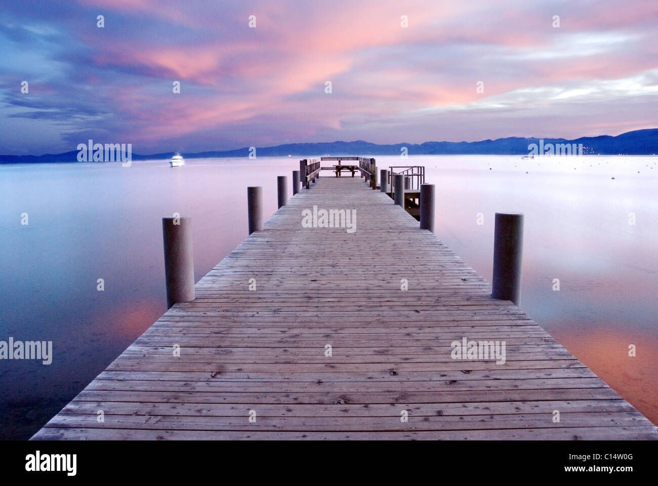 A pier at sunrise on the west shore of Lake Tahoe, California. - Stock Image
