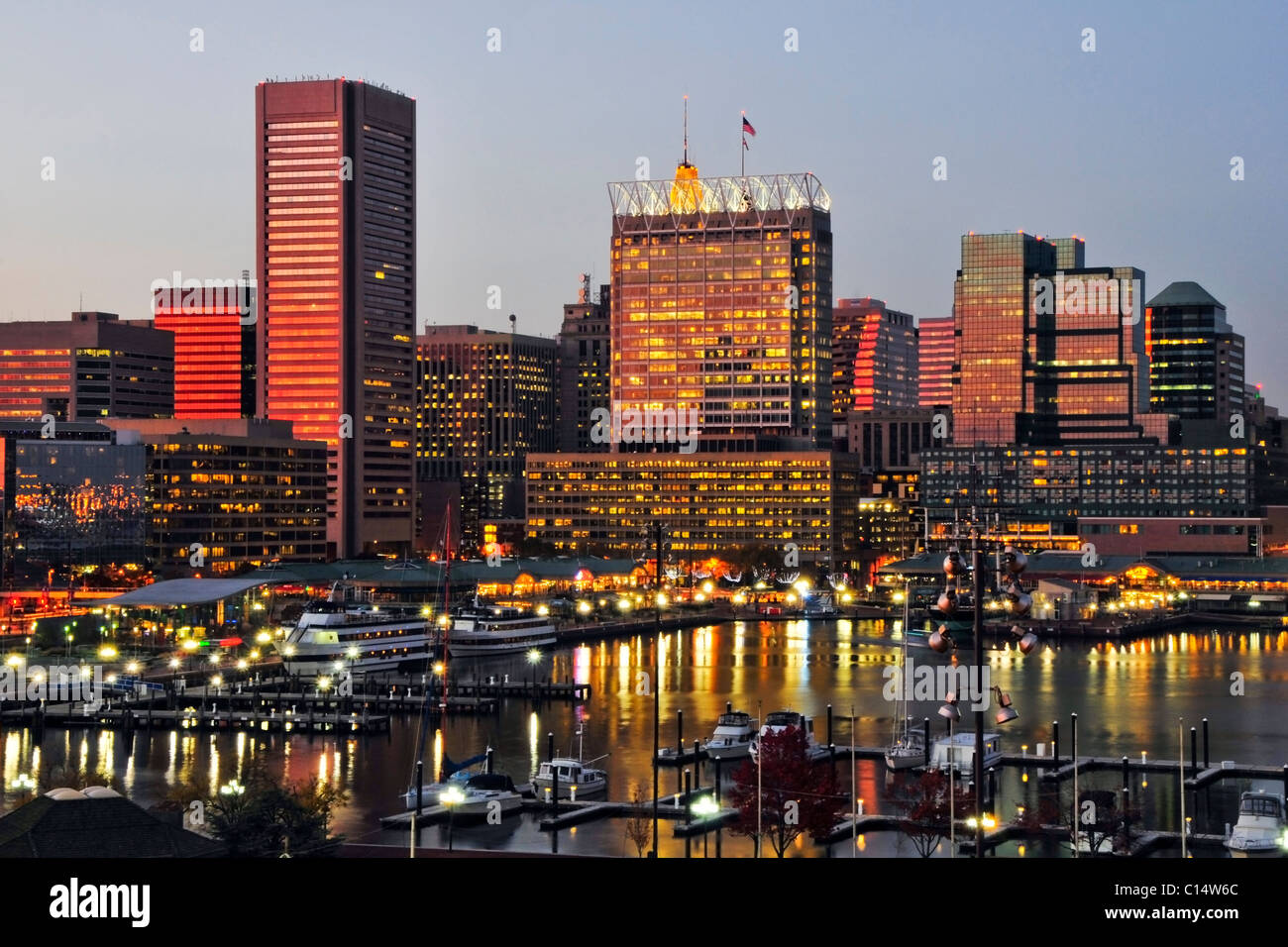 The sunset reflects off the windows of the Baltimore city skyline at dusk, Maryland. - Stock Image