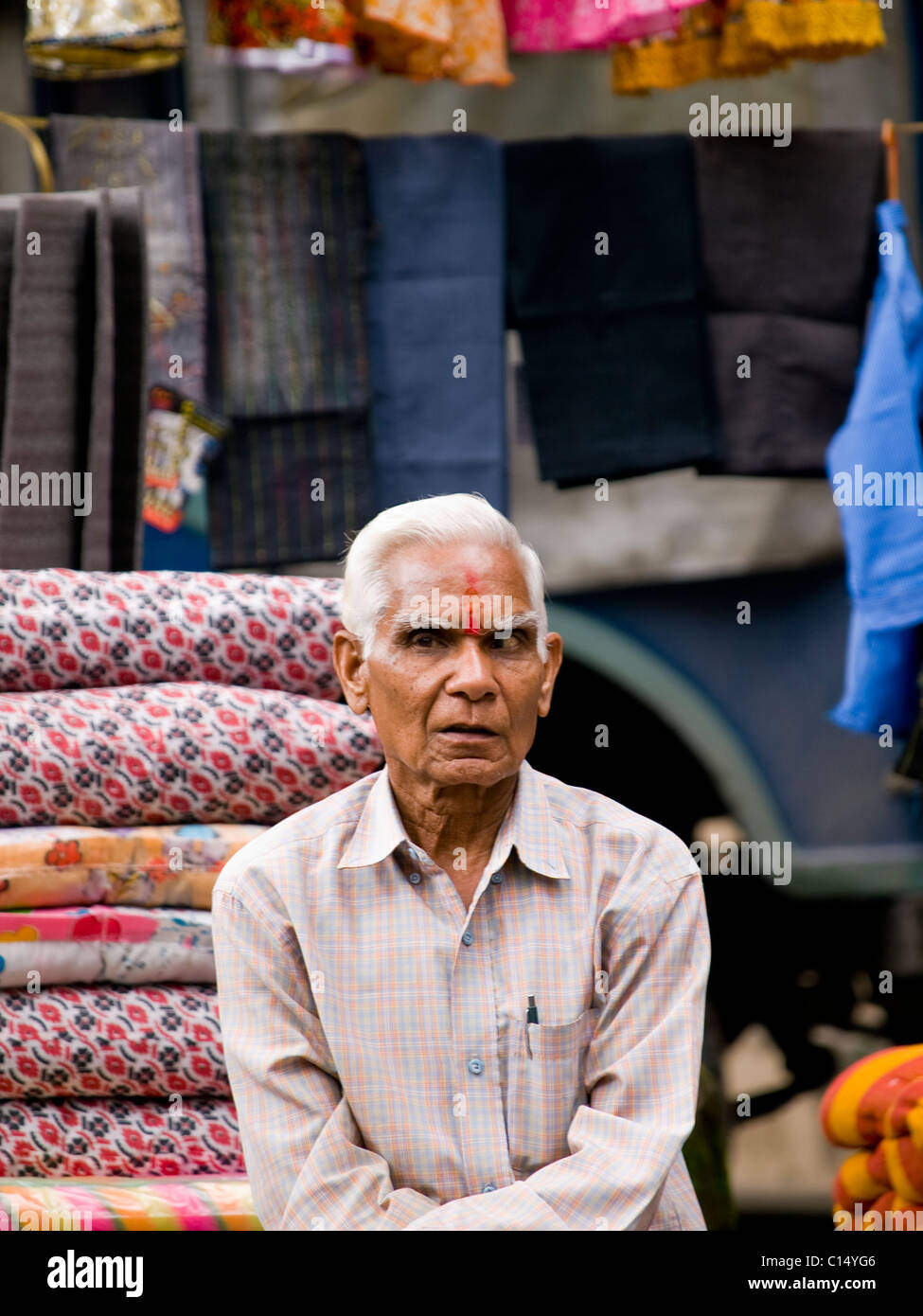 Man selling all kinds of wares on a market Stock Photo