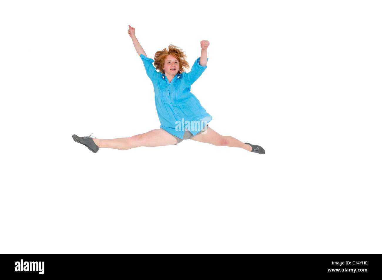 smiling young woman jumps with joy On white Background - Stock Image