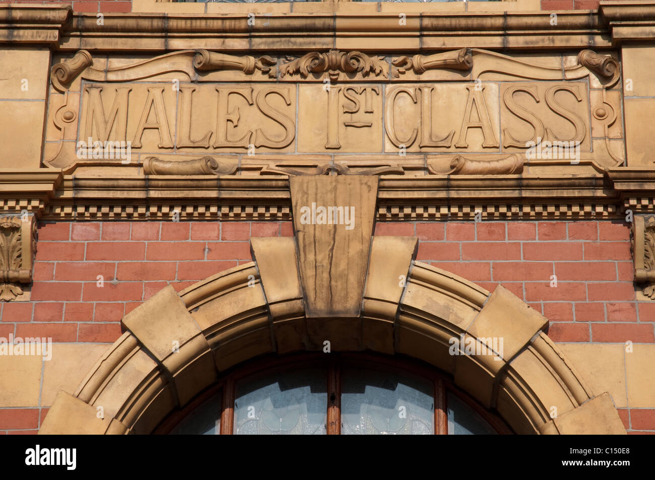 Males 1st Class, terracotta sign above doorway,Victoria Baths,Manchester.Closed in 1993 the building is now being - Stock Image