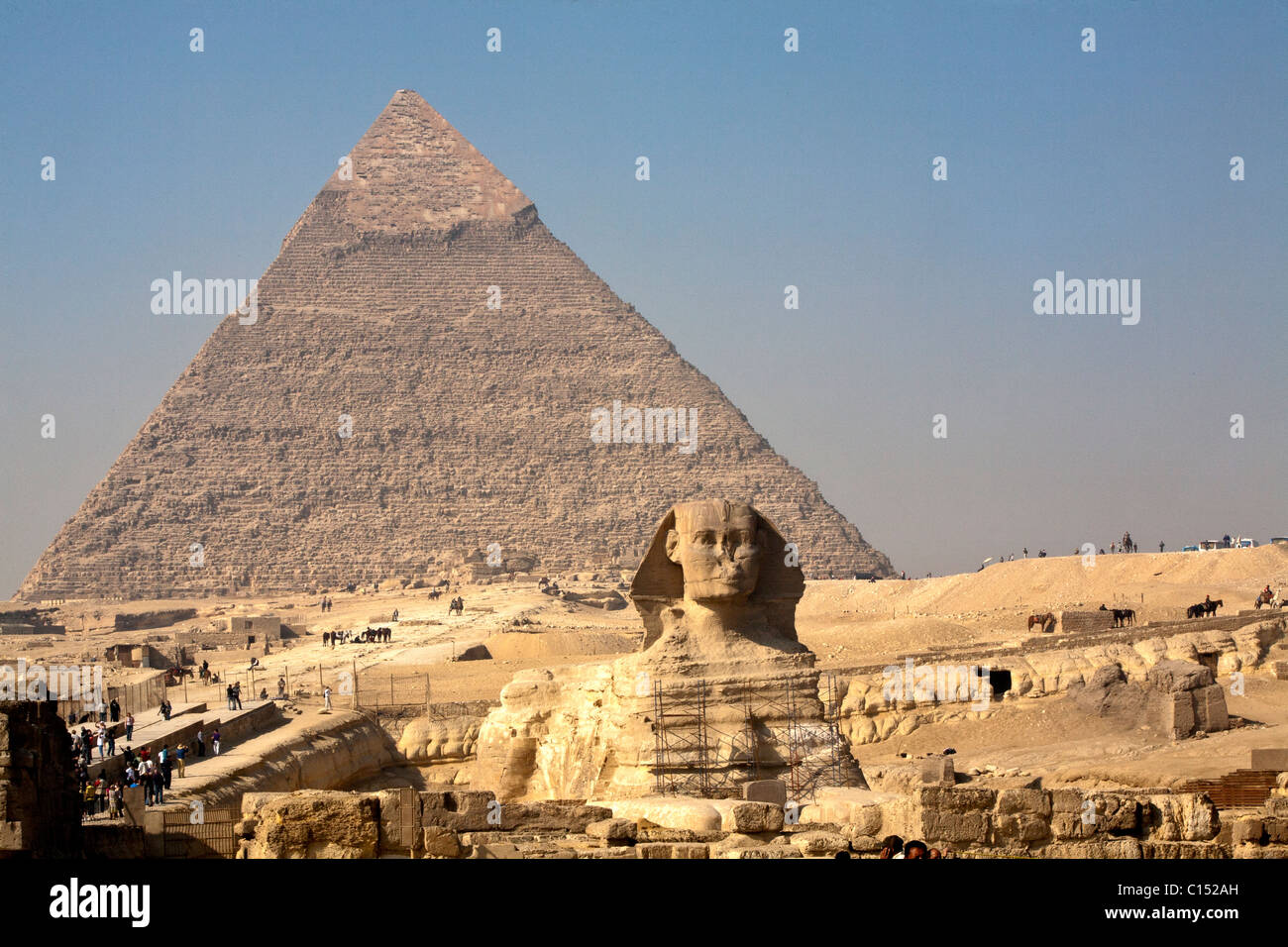 The morning smoke clears to view both the Great Sphinx of Giza and the Pyramid of Khafre (Chephren) in Egypt - Stock Image