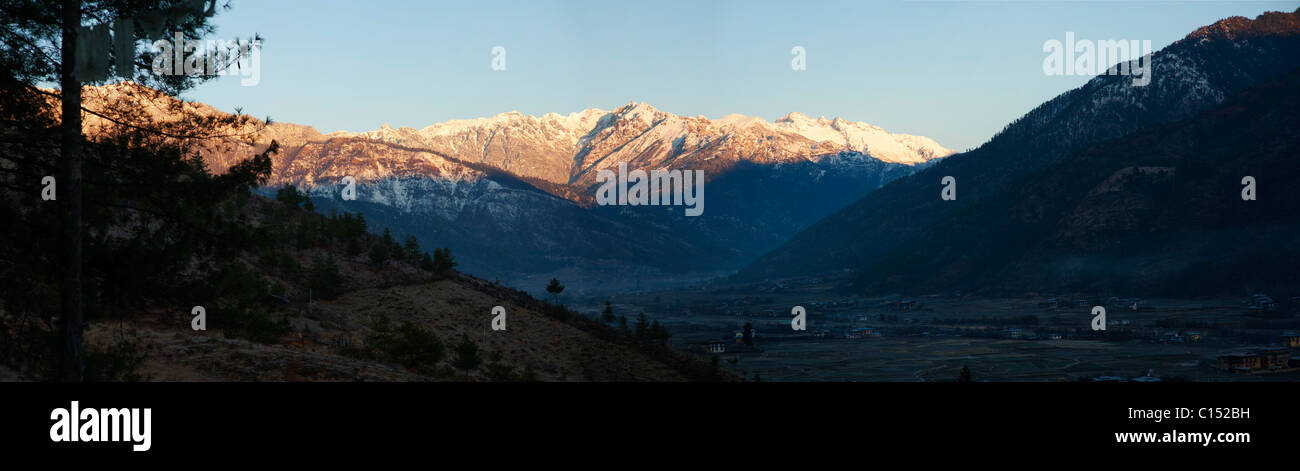 Panoramic view of the Paro Valley, Bhutan at dawn after a snow storm high in the Himalayan Mountains - Stock Image