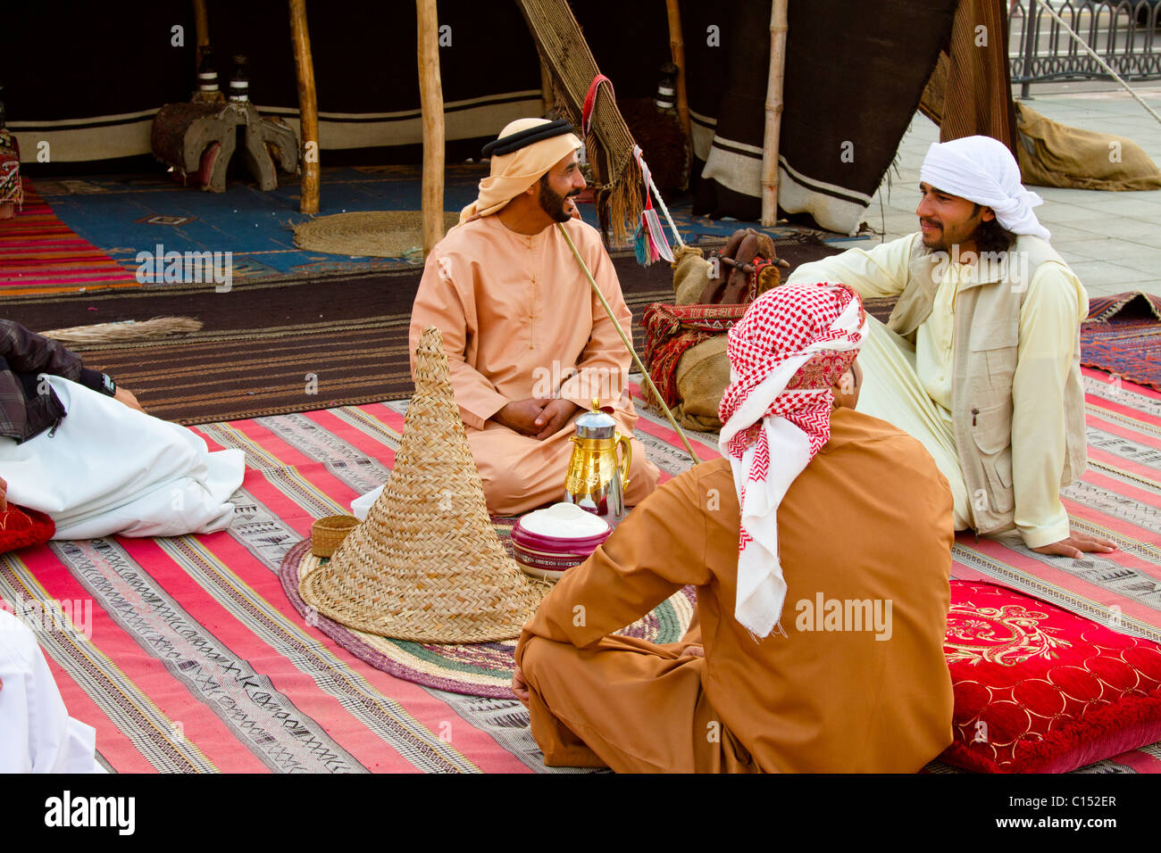 f51b934d1 Arab men in traditional dress at a camp along Dubai Creek in Dubai