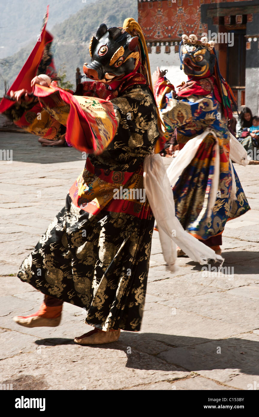Bhutanese monks prepare to dance in a Buddhist festival in the central Bhutanese dzong of Trongsa. - Stock Image